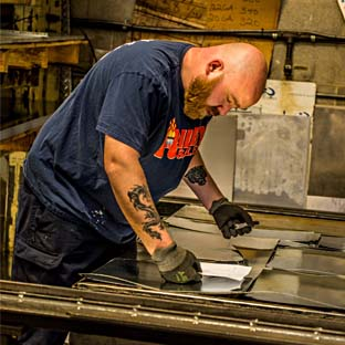 Keith looking over an order in the Riley Industries sheet metal shop